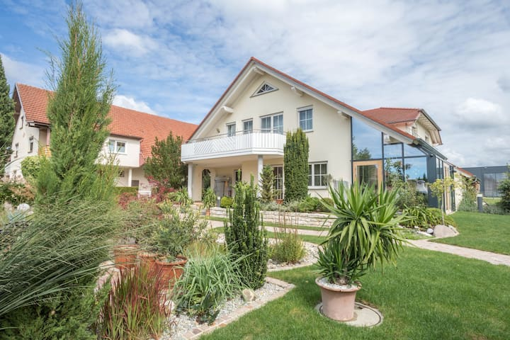 """Well-Furnished Apartment """"Ferienwohnung Welte"""" close to Lake Constance with Mountain View, Wi-Fi, Balcony, Garden & Pool; Parking Available"""