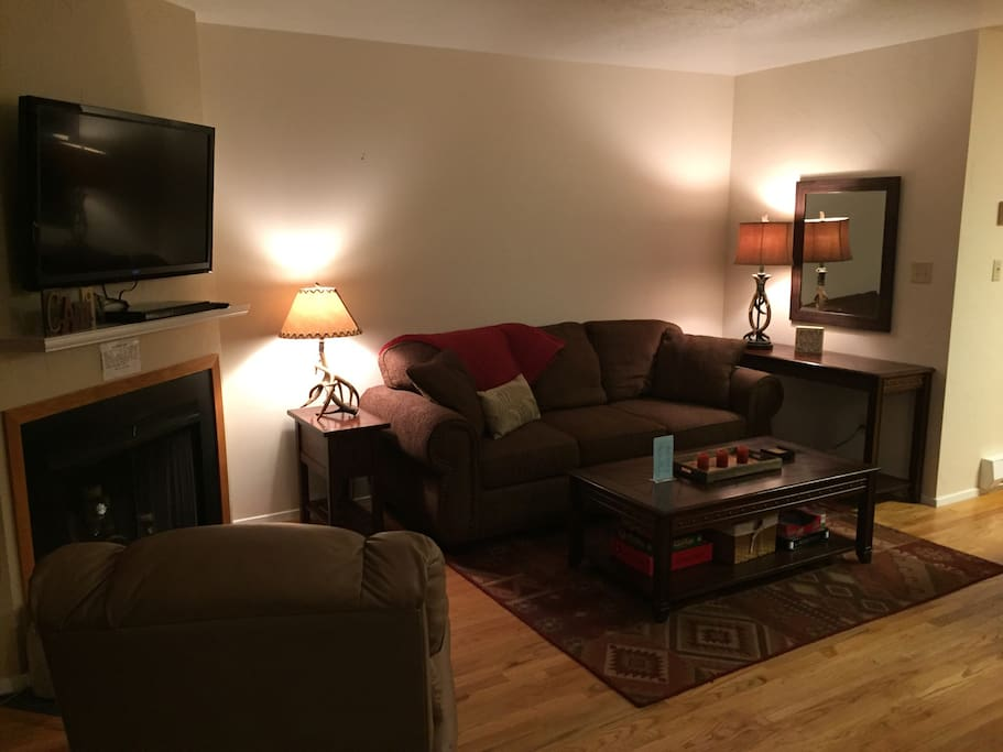 "Living room with recliner, 42"" tv, blu ray player, and  comfortable pull out sofa"