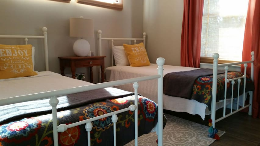 Twin beds in south bedroom.