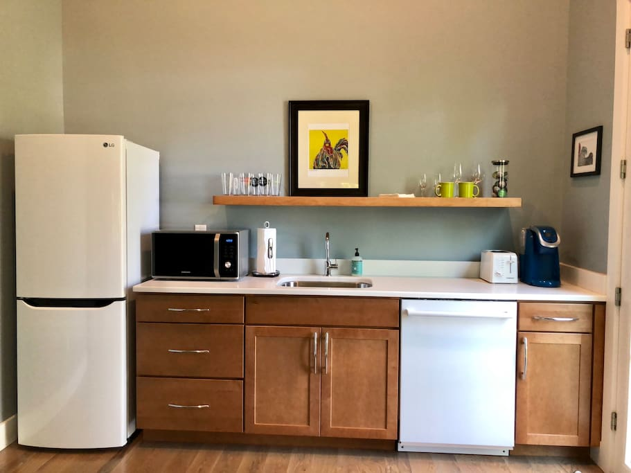 Kitchenette with fridge, microwave, toaster, and Keurig coffee maker.