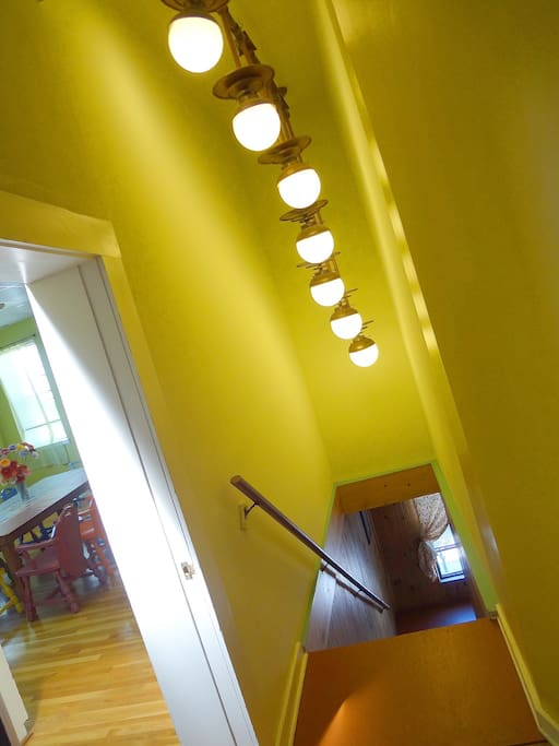 Sculptural light fixture in private entry stairwell