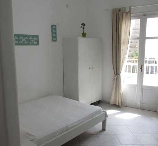 Room at the rear  - with balcony.  1 double + 1 single bed.  To see videos of the rooms, please try you tube hotel parko channel.