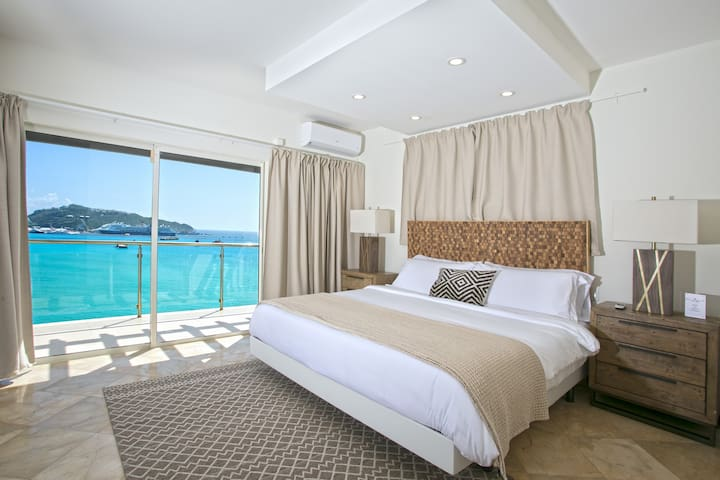 Easy access to the porch and a wonderful view of the ocean makes going for an early morning swim in the pool, a breeze!.