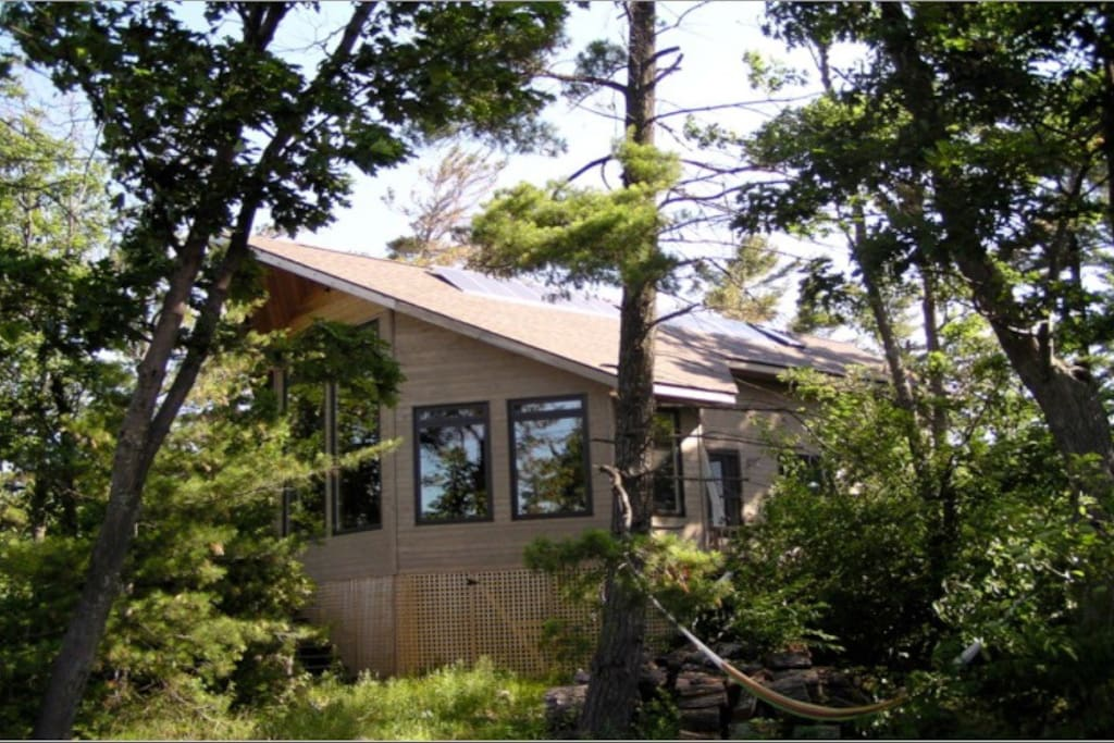 View of the front of the cottage...the large picture windows face southwest.