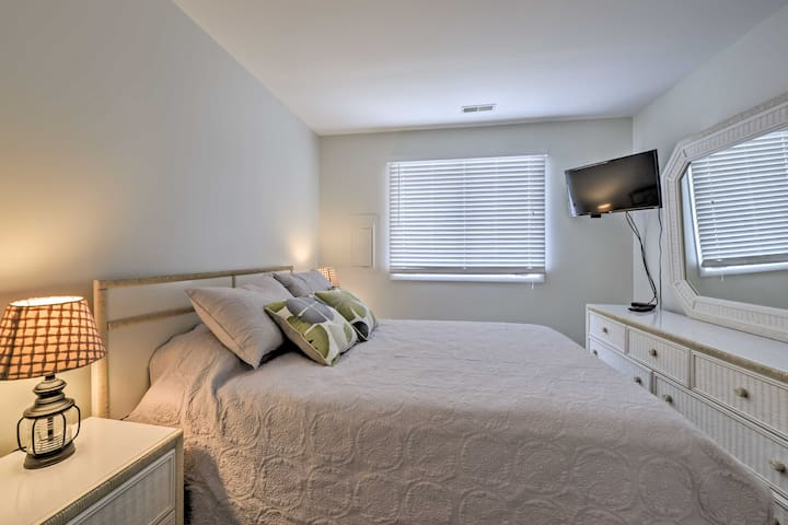 The master bedroom boasts a plush queen-sized bed and flat-screen cable TV.