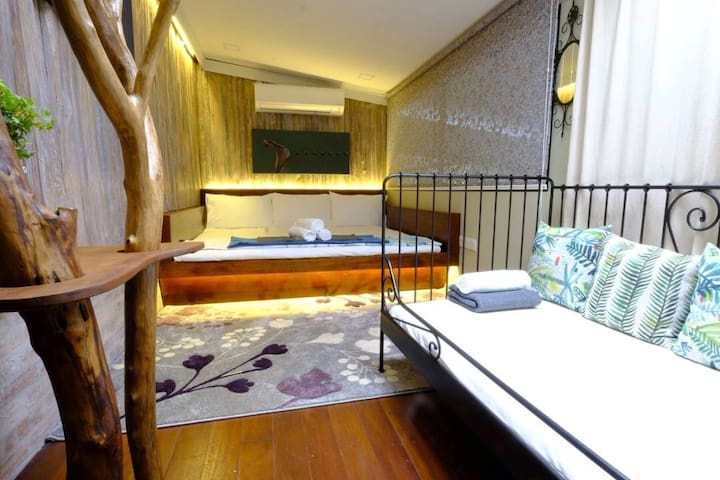 Room with a King Size bed and a Single Bed