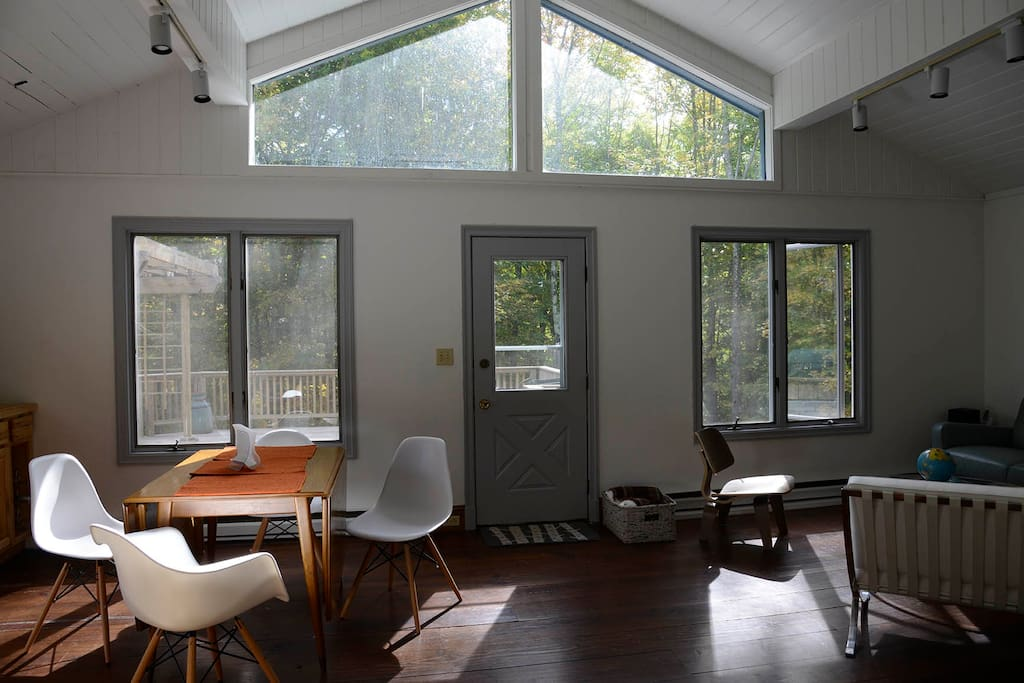 Sunlight floods the windows in the open living and dining rooms