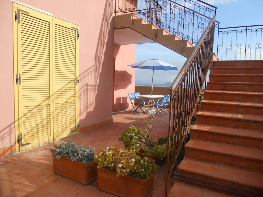 Terrazza e finestra della camera. The terrace and the bedroom window