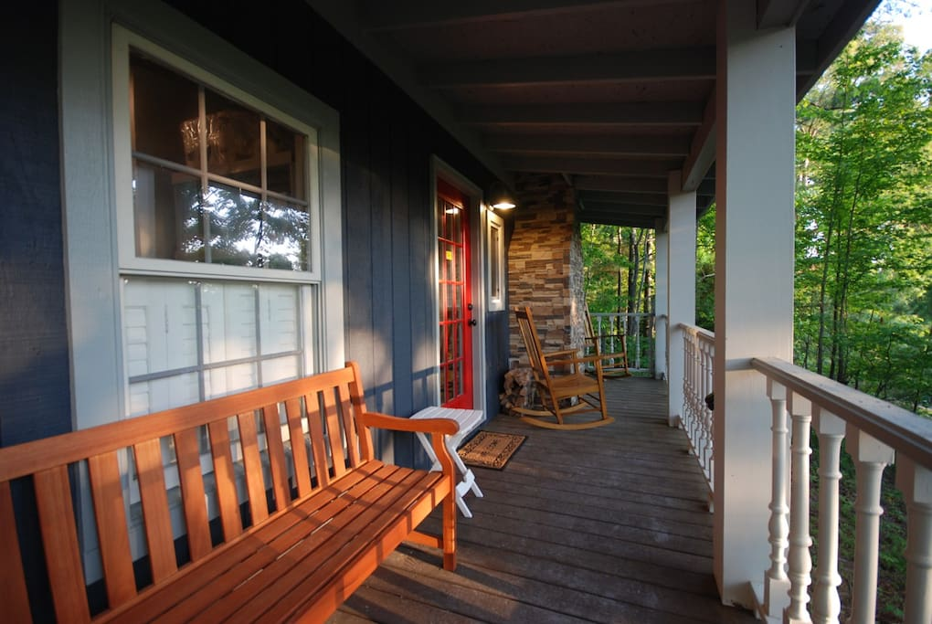 The inviting front porch is the perfect evening spot to unwind, whittle & relax