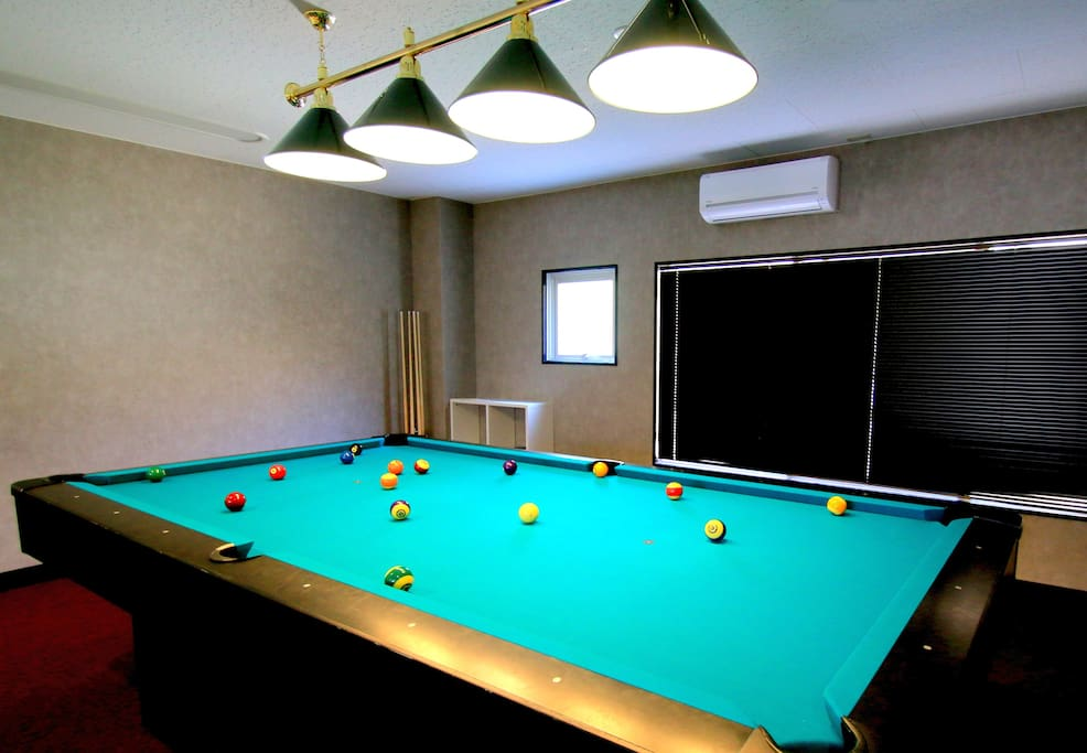 Our venue features a large billiard room for the ultimate pool experience with friends