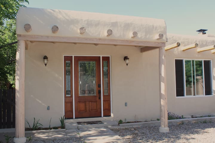 Main entrance of the home with traditional vigas