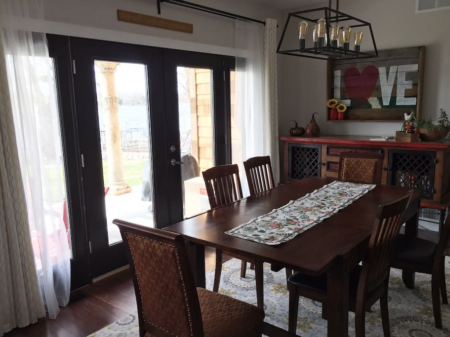 Dining room. Seats 6 comfortably. Walk out to patio. Open layout to kitchen and living room