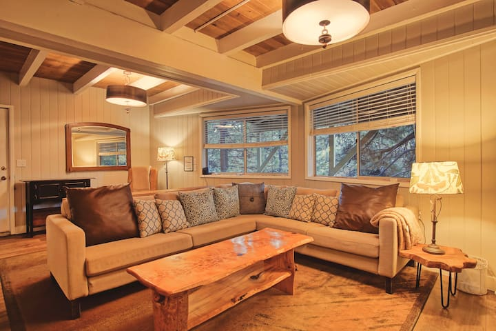 Spacious downstairs media/family room offers plenty of room to gather and relax
