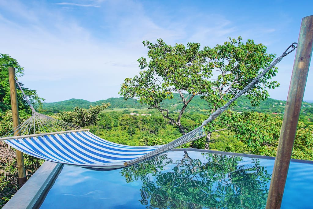 Hammock above water with impressive view