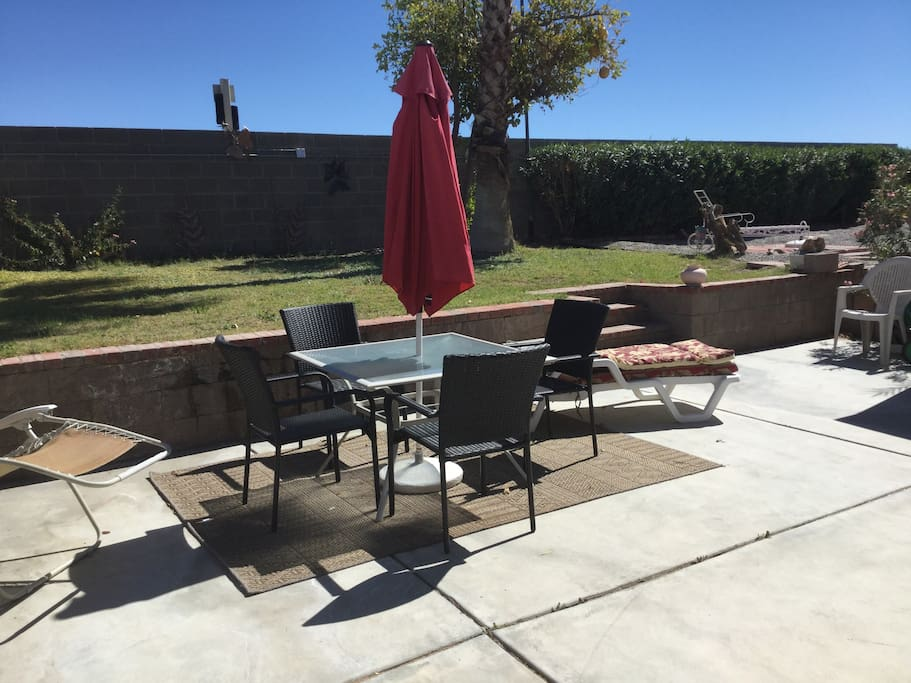 The patio in the back yard is a great place to lounge and relax.