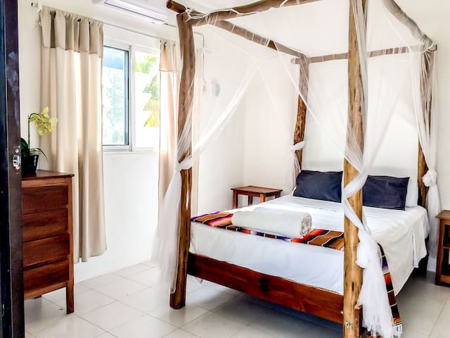 Bedroom 1 - 1 double bed and patio doors onto terrace overlooking beach (Upstairs)