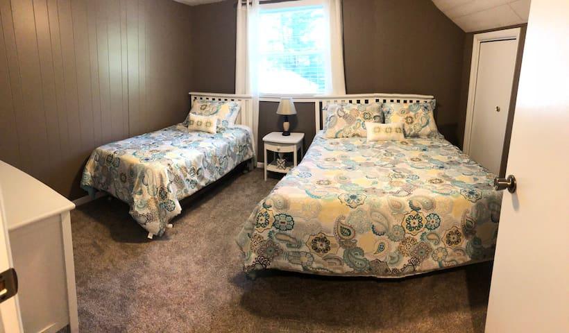 Queen and twin bedroom upstairs