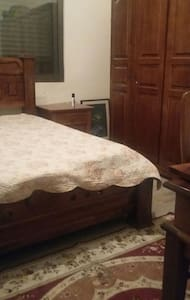 A warm bedroom in our lovely home - Amman