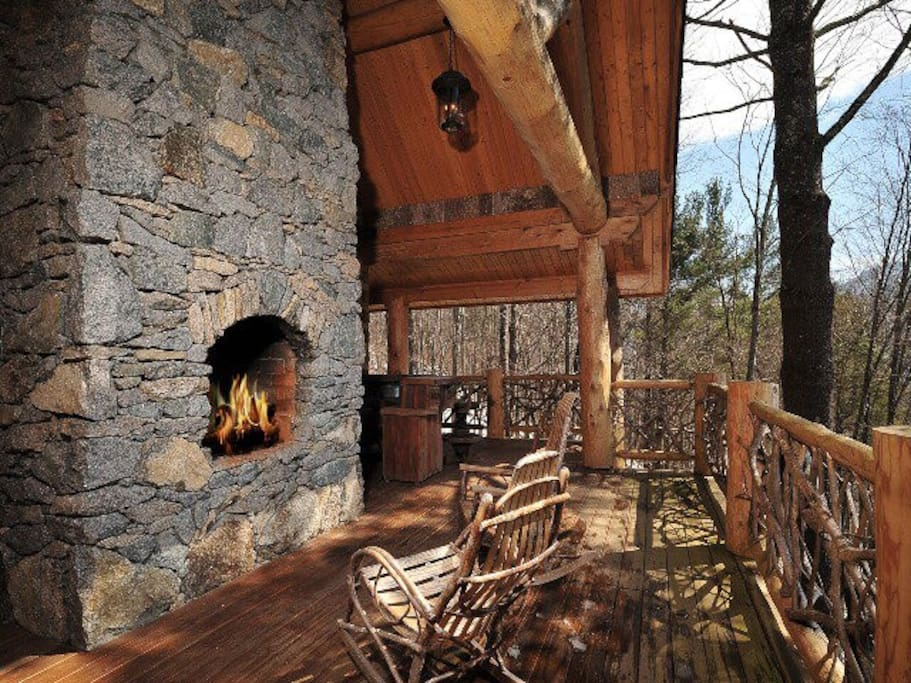 A view of the mountains alongside the outdoor fireplace.