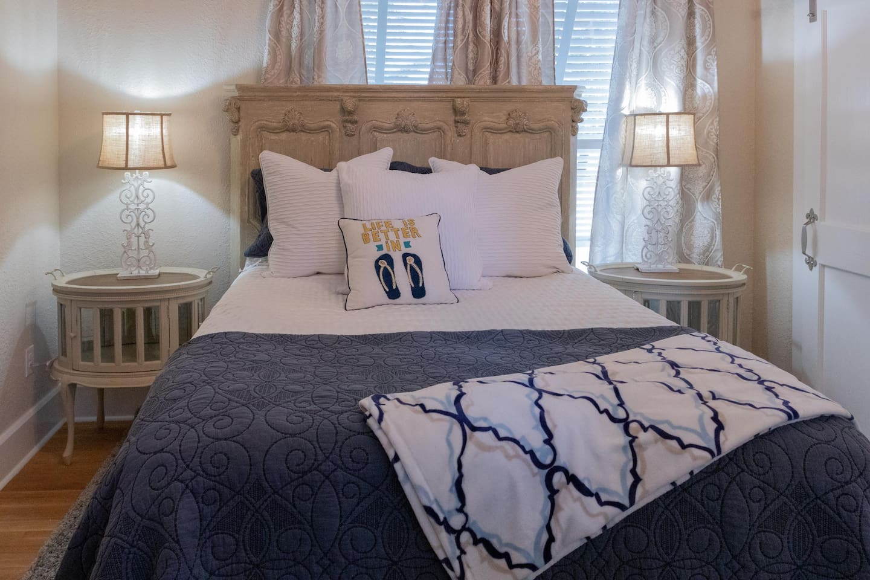 Close-up view of bedroom queen bed & two nightstands