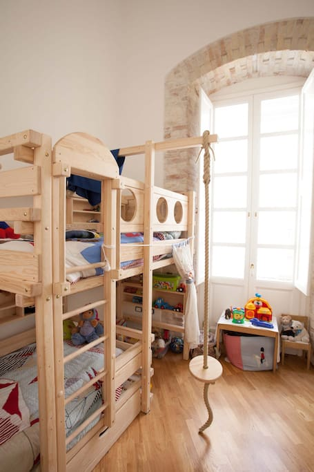 Childrens bedroom with 2 single beds, toys, playing area