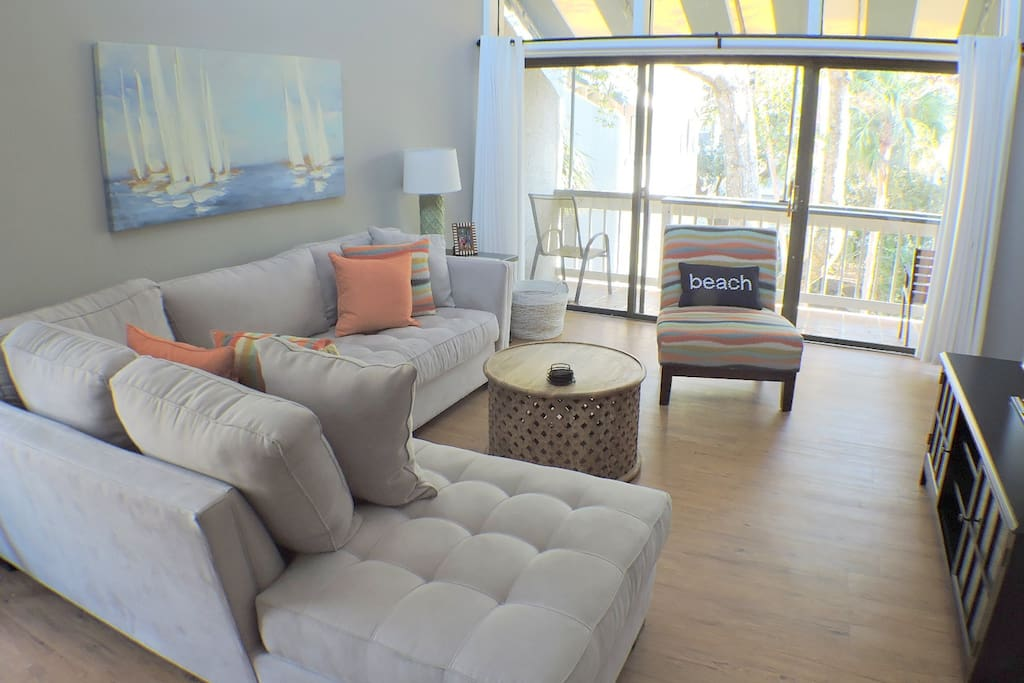 Comfortable living room also provides access to balcony.