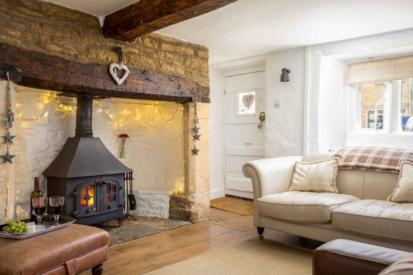 Plenty of comfortable seating, a large inglenook fireplace and cosy wood burning stove