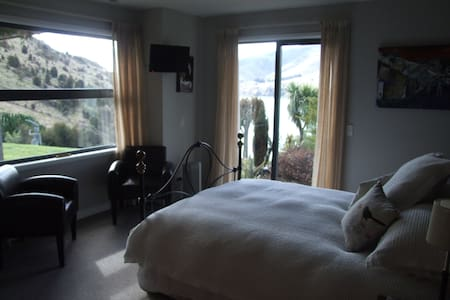 Main Bedroom, with en suite, also, includes a refreshment cupboard with fridge, tea and coffee making facilities, complimentary biscuits and bottled water. Flat screen TV in your room, allows you to play DVD Films and CD music from your own library.
