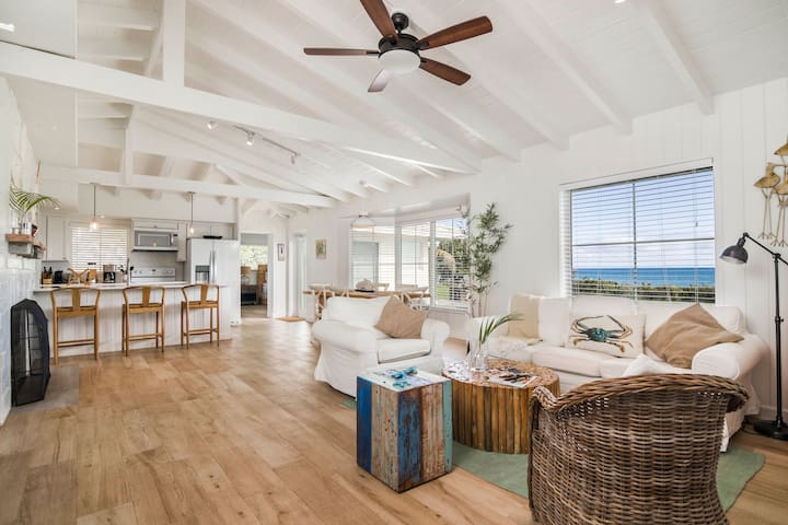 Gull House Open living room, dining room and kitchen with ocean views.