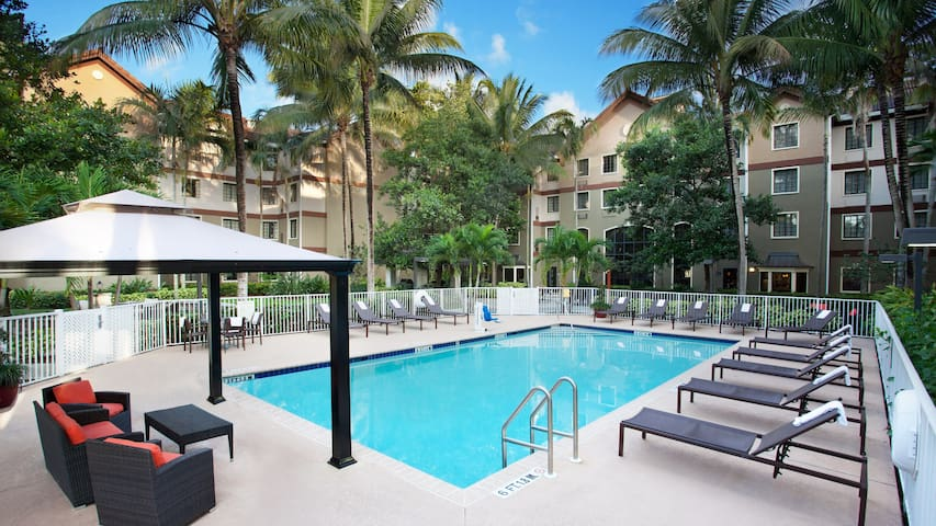 Suite with Complimentary Shuttle Access! |  Free Breakfast + Pool Access!