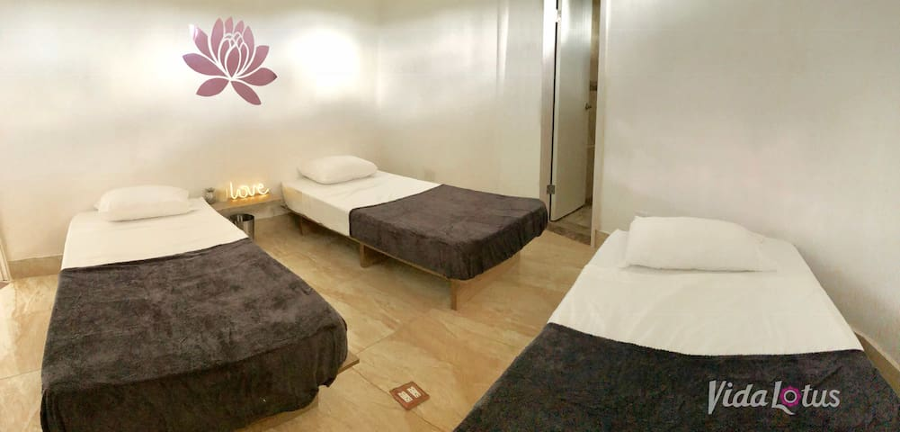 Shared triple room in our Holistic Healing Center