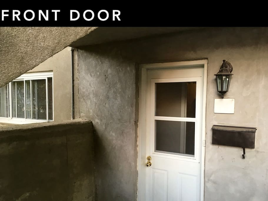 Front door and entrance to the apartment in the basement
