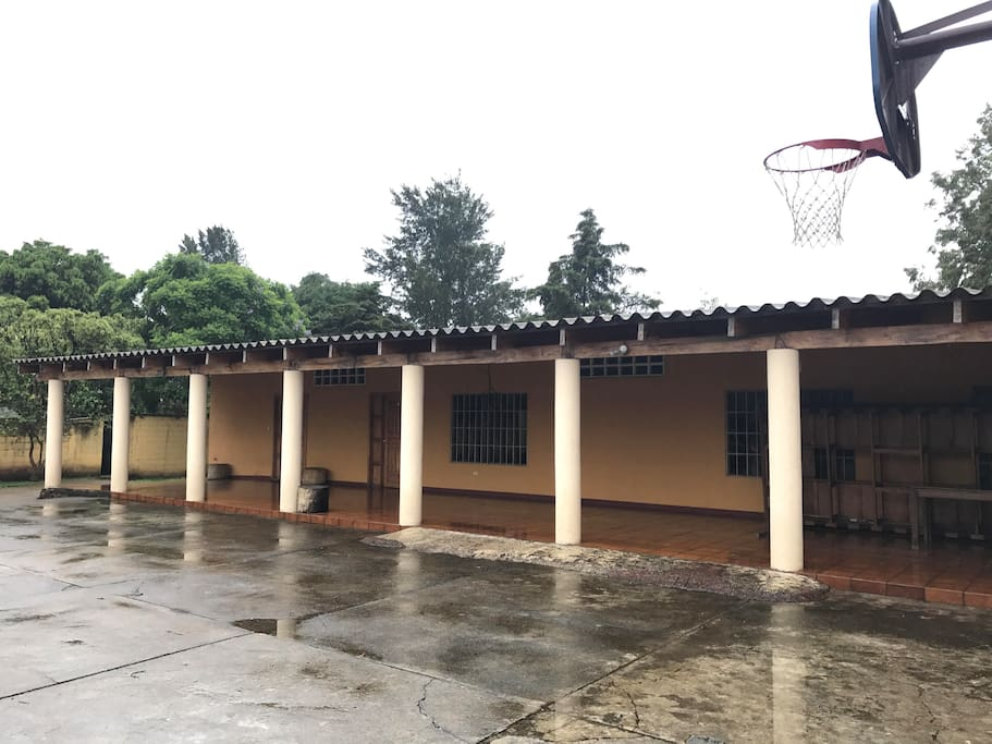 Parking area with basketball net.