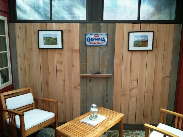 Lots of natural light and wood. Built in vintage beer sign, mountain photos, shelf with carved bottle opener.