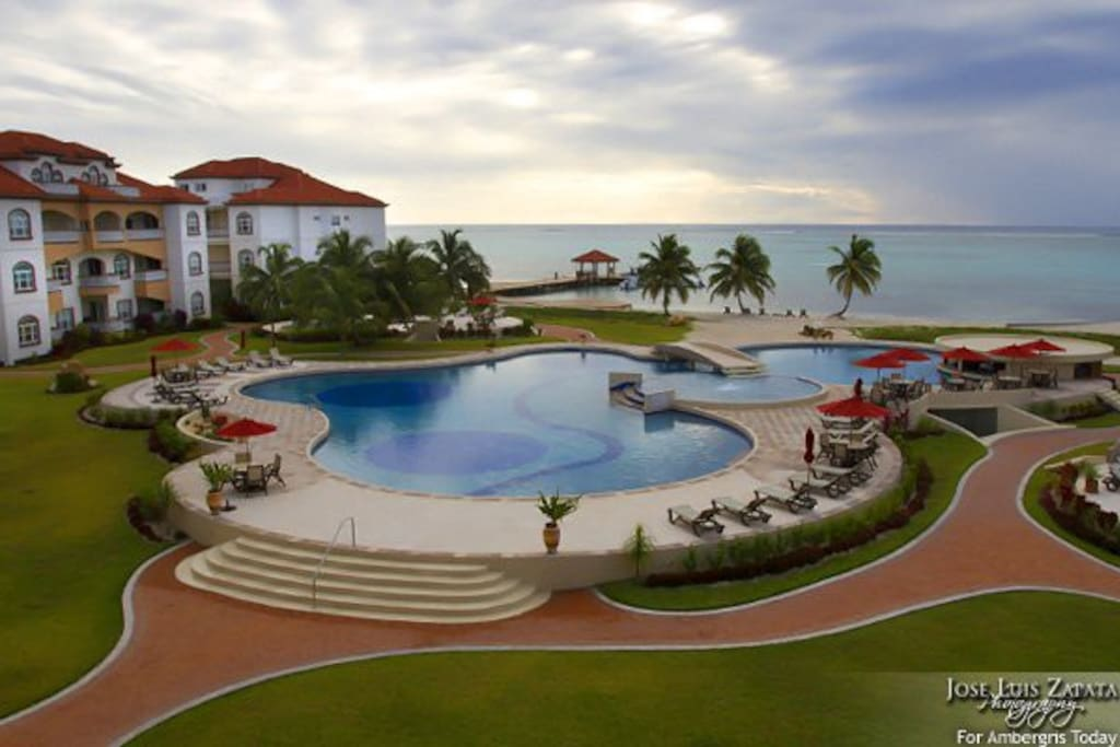 Main swimming pool with restaurant and swim-up bar (1 of 10 swimming pools on premises)