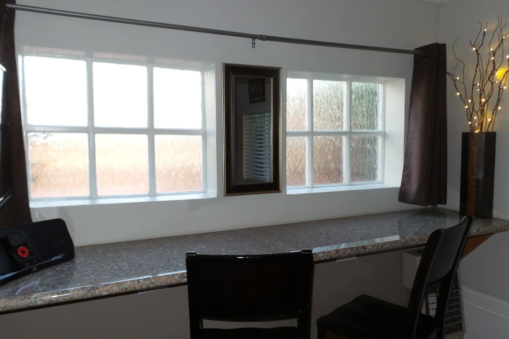 Decretive privacy windows at the front of the cottage over eating bar & workspace.