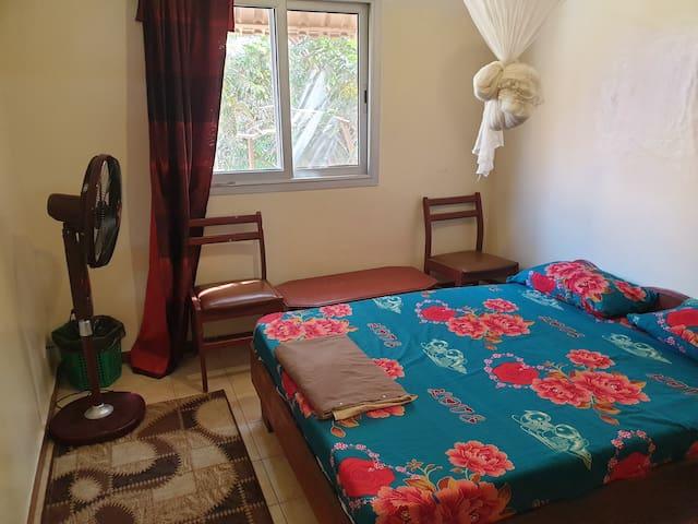 Chambre Cozy Chez l'habitant avec cuisine et Salon
