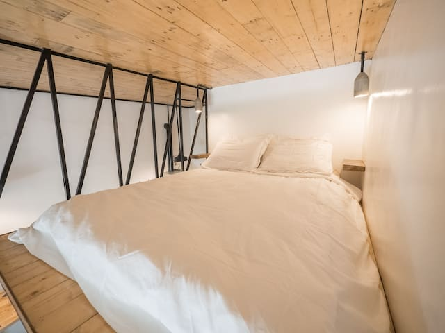 The queen sized bed is perfect for singles or couples looking to get away from it all