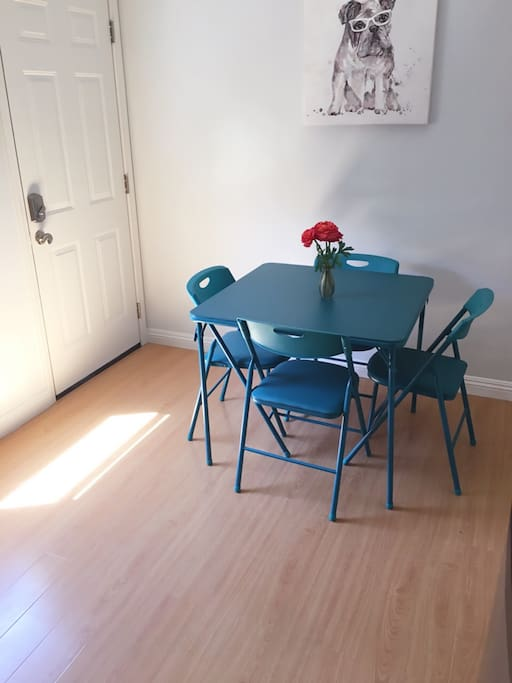 Two modern chic matching tables to sit 8
