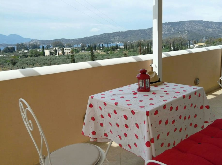 Balcony's view combines the blue color of Saronic golf and the green color of the famous Trizinian olive trees.