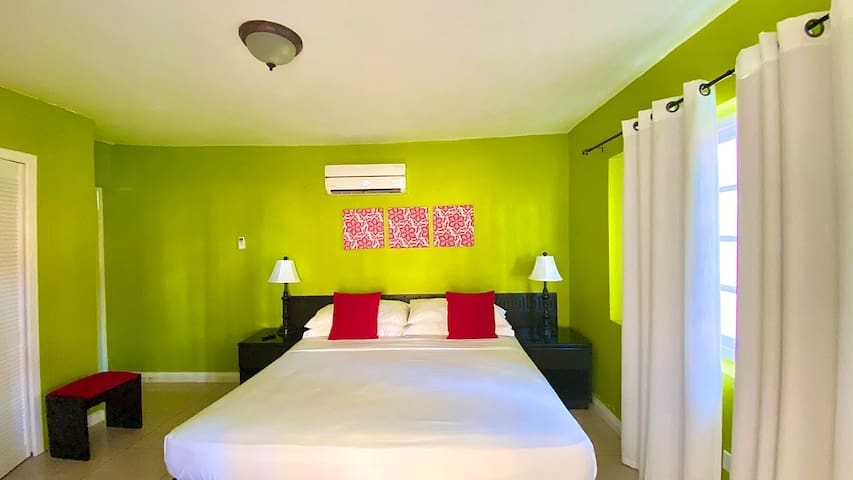 Spacious bedroom with king size bed, night lamp, USB charger, Air-conditioner & more...