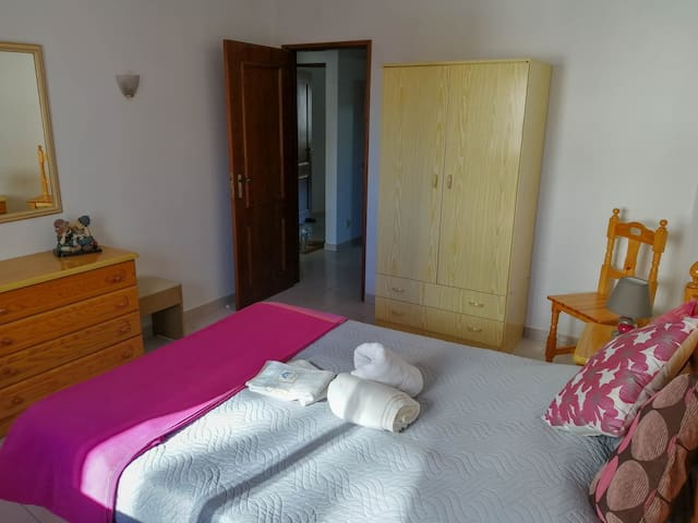 Bedroom with dresser and wardrobe