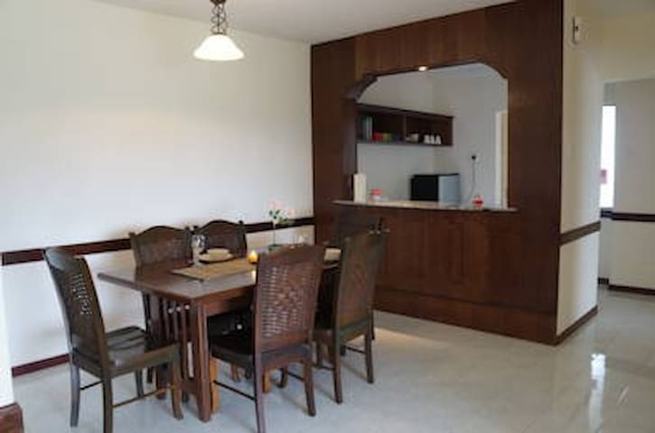Dining area with dinning table complete with 6 chairs