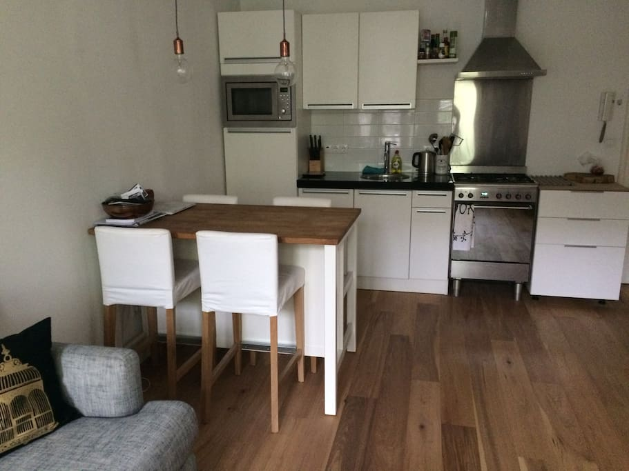clean kitchen and 4-persons table