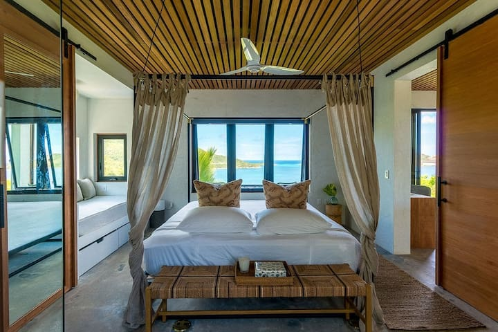Master bedroom with views of the Caribbean Sea, North Sound & Moskito Island