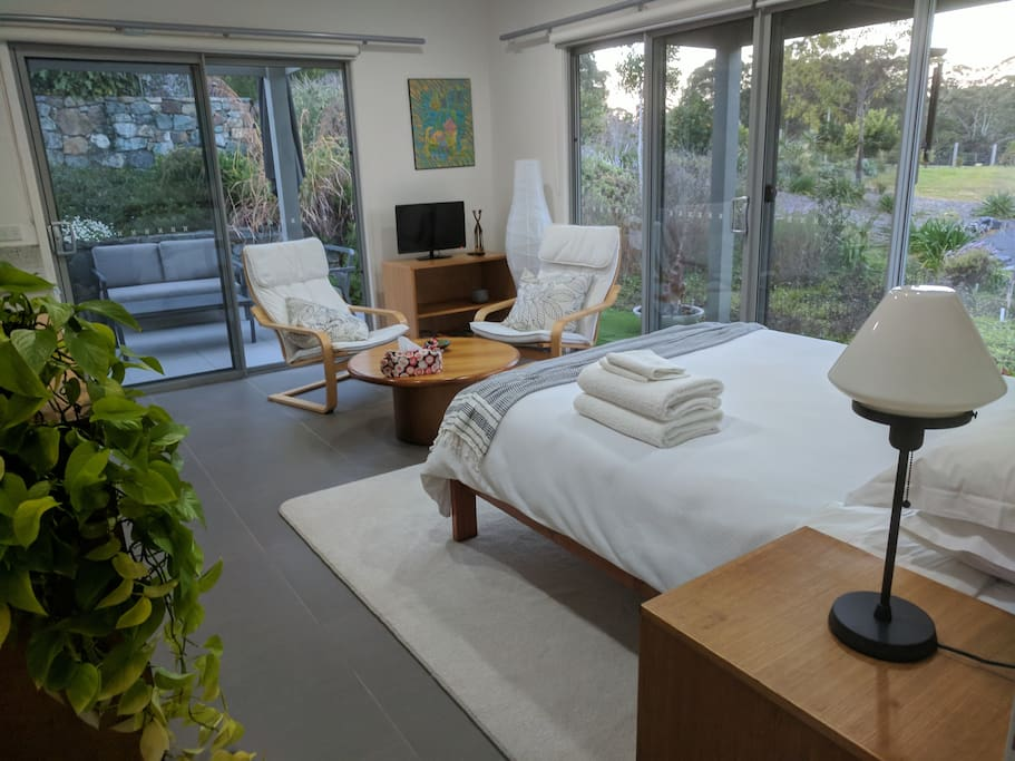 The room has east and north facing sliding doors