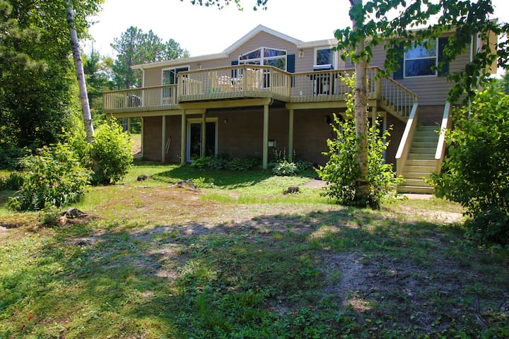 Private Riverfront Location Centered on 2 acres