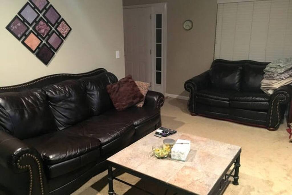 Comfortable living area for relaxing after being out enjoying Nashville! Wifi, TV, DVD player, Roku & much more.