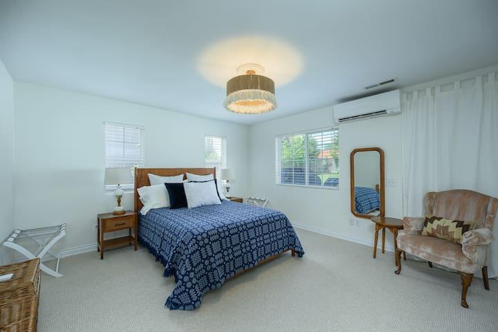 Main bedroom on main floor, with queen bed