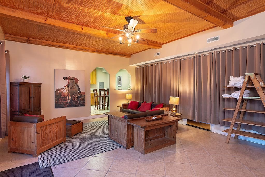 Our Allegheny Suites features a spacious sitting area with large screen TV and beautiful rustic decor.